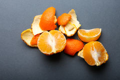 Peeled tangerine on grey background Stock Images