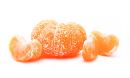 Peeled tangerine or mandarin fruit isolated on a white Royalty Free Stock Photos