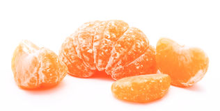 Peeled tangerine or mandarin fruit isolated on a white Stock Photo
