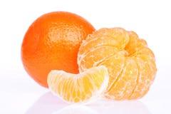 Peeled tangerine or mandarin fruit on white Royalty Free Stock Images