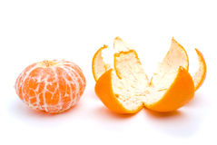 Peeled tangerine and peel Stock Photos