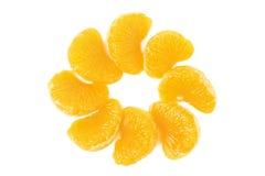 Peeled tangerine sections. Slices of peeled orange tangerine isolated on white background Stock Images