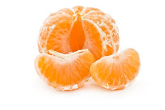 Peeled tangerine with a slice Royalty Free Stock Images
