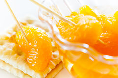 Peeled tangerine slices on a cookie Stock Photo