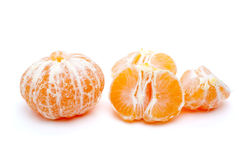 Peeled tangerine and some segments Stock Photography