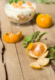 Peeled tangerine with a sprig of mint Stock Photography