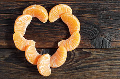 Peeled tangerine on table Royalty Free Stock Images