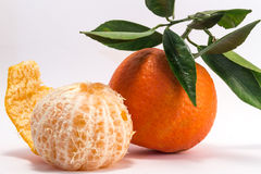 Peeled Tangerine and Tangerine Royalty Free Stock Image