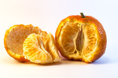 Peeled tangerine. On white background. Ideal for layout Stock Photo