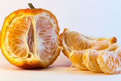 Peeled tangerine. On white background. Ideal for layout Royalty Free Stock Images