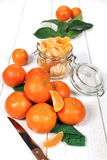Peeled tangerines in glass jar Royalty Free Stock Images