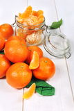 Peeled tangerines in a glass jar Royalty Free Stock Images