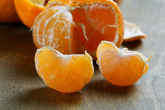 Peeled tangerines with slices Royalty Free Stock Photography