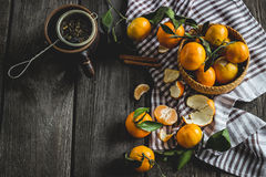 The peeled tangerines on a wooden table Royalty Free Stock Images