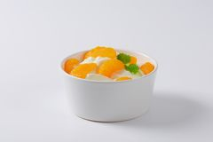 Peeled tangerines with yoghurt Royalty Free Stock Image