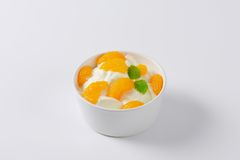 Peeled tangerines with yoghurt Royalty Free Stock Photography