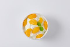 Peeled tangerines with yoghurt Royalty Free Stock Photo