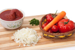 Peeled tomato, dill, chopped onions and carrot for  food prepara Royalty Free Stock Image