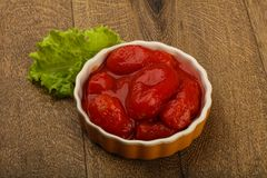 Peeled tomatoes. With juice in the bowl Royalty Free Stock Image