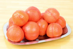 Peeled tomatoes Stock Images
