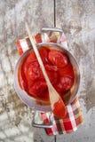 Peeled tomatoes. Preparation of a pan sauce of San Marzano peeled tomato quality Stock Image