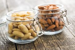 Peeled and unpeeled almonds royalty free stock photography