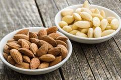 Peeled and unpeeled almonds stock image