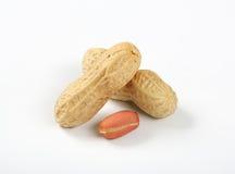 Peeled and unpeeled peanuts Stock Photo