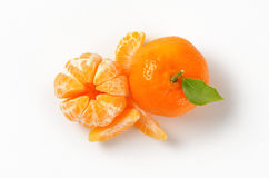 Peeled and unpeeled tangerines Royalty Free Stock Photo