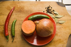 Peeled vegetables on board Stock Images