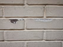 Peeled wall cracks and hole in the wall. White brick abstract design texture object isolated ideal perfection Royalty Free Stock Images