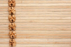 Peeled  walnut lying on a bamboo mat Royalty Free Stock Photo