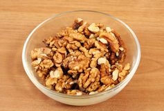 Peeled walnuts in bowl Stock Image