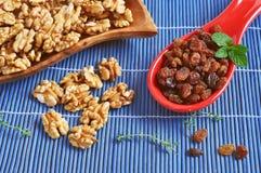Peeled walnuts and dry raisins Royalty Free Stock Photo