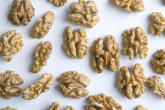 Peeled walnuts. On a white background Stock Images
