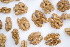 Peeled walnuts. On a white background Royalty Free Stock Image