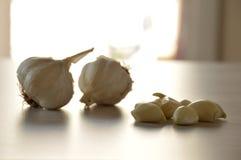 Peeled and whole garlic royalty free stock photography