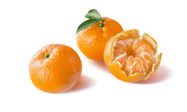 Peeled and whole mandarin with water drops  on white Royalty Free Stock Photos