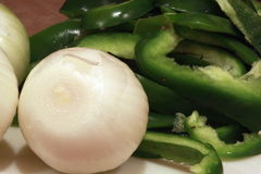 Peeled Whole Onions and Green Pepper Slices Royalty Free Stock Photos