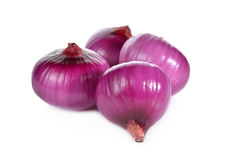 Peeled whole red onion, shallots on white Stock Image