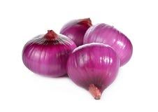 Peeled whole red onion, shallots on white Stock Image