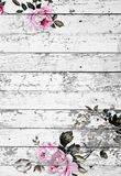 Peeled wooden texture with shabby chic vintage roses. Peeled wooden surface texture with shabby chic vintage rose decorations and copy space for your text Stock Images