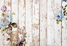Peeled wooden texture with shabby chic vintage roses stock photos