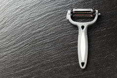 Peeler on a black background Royalty Free Stock Images