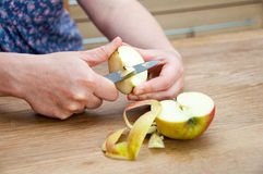Peeling an apple Royalty Free Stock Photography