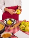 Peeling apples for pie Stock Image