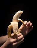 Peeling a banana Stock Photo