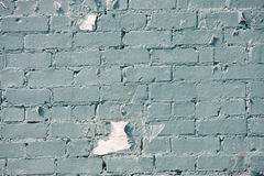 Peeling Blue Paint on Old Brick Wall Stock Photo