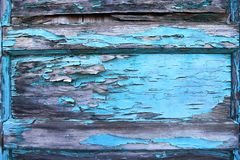Peeling blue paint on old wood door. Background texture stock photography