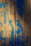 Peeling blue paint on wood Stock Images